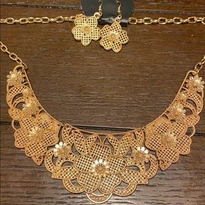 Gold floral bib necklace with matching earrings